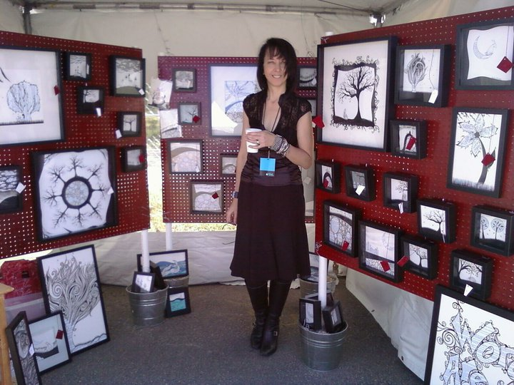 Marta with her creations at an art fair in Austin, TX.