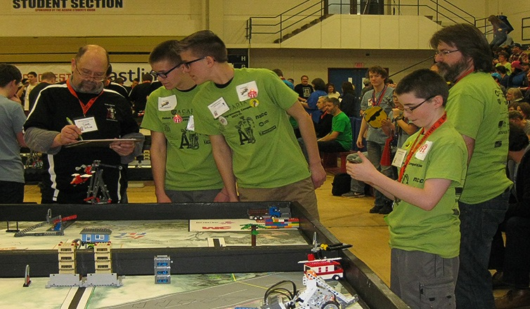 the Flying Manatees review a robot run at the Nova Scotia Championship.